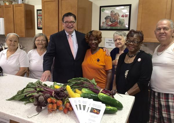 Mr. Hughes presents fresh produce vouchers to senior citizens, Lawrence NJ