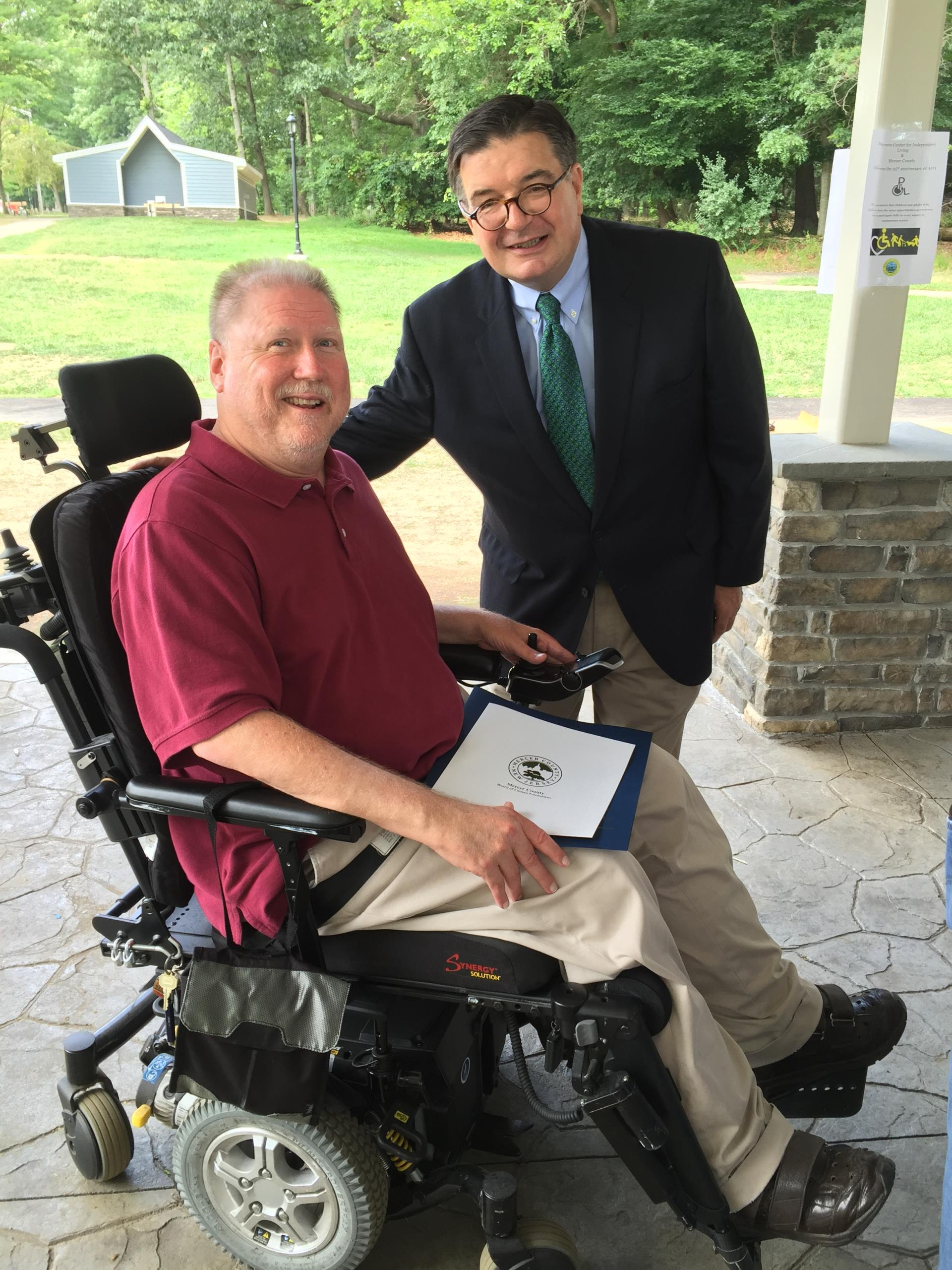 County Executive Brian Hughes with Scott Elliott of Progressive Center for Independent Living