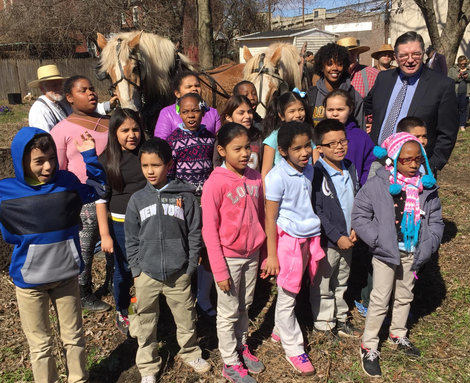 Mr. Hughes with students at Isles Community Gardens Plowing Day