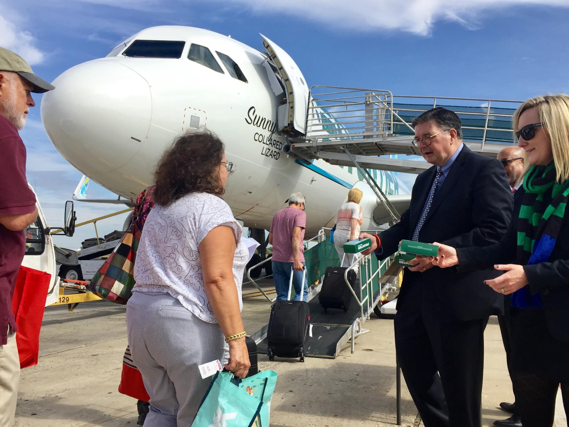 Greeting passengers boarding  Frontier Airlines flight to West Palm Beach